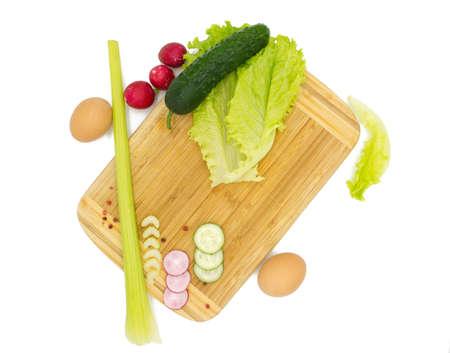 Salad ingredients. Vegetables on a wooden board