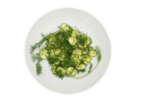 Cucumber salad with dill in a large white bowl, top view