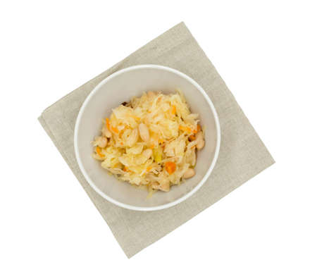 Sauerkraut salad with beans and carrots, top view