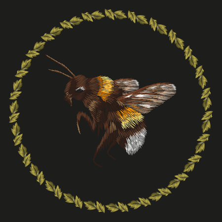 Embroidery colorful trend pattern with bumblebee. Vector folk striped bee with ring of leaves ornament on black background. Illustration