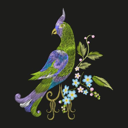 Embroidery colorful floral pattern with fantasy parrot. Vector trend folk green bird with flowers ornament on black background. Illustration