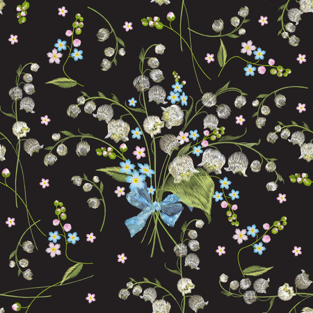 Embroidery colorful seamless pattern with lilies of the valley and forget me not flowers. Vector traditional folk floral ornament on black background for design.