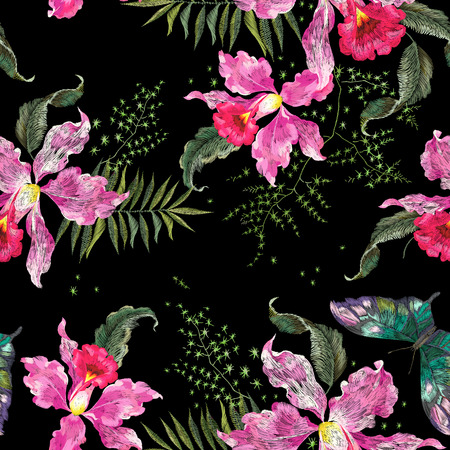 Embroidery trend floral seamless pattern with orchids and butterfly. Vector traditional embroidered bouquet with exotic flowers on black background for clothing design.
