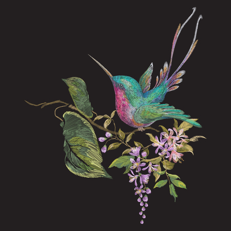 Embroidery fashion pattern with hummingbird on branch of exotic flowers. Vector embroidered floral ornament with bird on black background for clothing design.