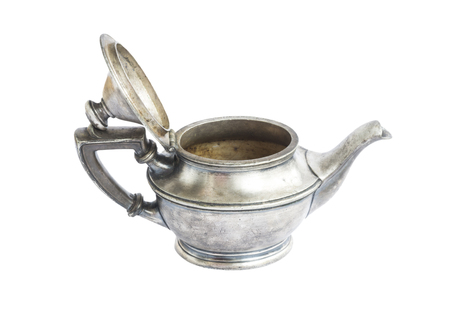 antique dishes: Antique silver teapot isolated on white background Stock Photo