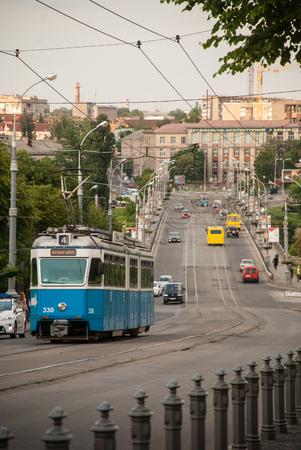 tramline: Old blue tram on the city street