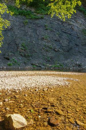 sandbank: Sandbank on a mountain river with rocky shores Stock Photo