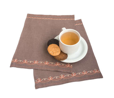 compote: Cup with a compote and cookies on a napkin embroidered Stock Photo