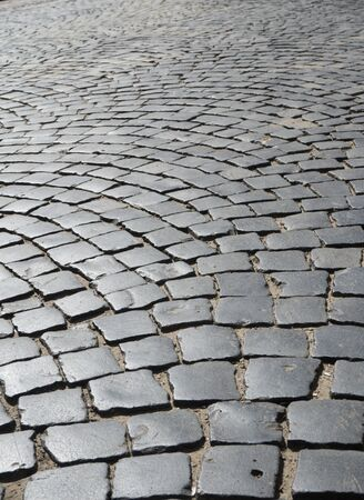 cobbles: Cobbles on the road of the old town. Chernivtsi - an ancient city in western Ukraine Stock Photo