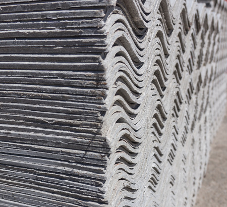 building material: Pack sheets of asbestos slate. Building material for roofing
