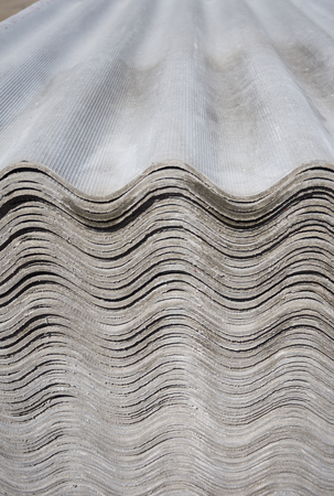 asbestos: Pack sheets of asbestos slate. Building material for roofing