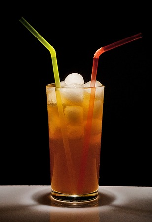 specular: Tall glass with a drink and ice