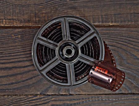 Equipment for film development on the dark wooden surface. Stock Photo