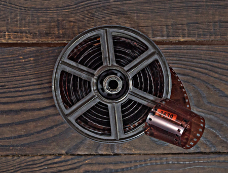specular: Equipment for film development on the dark wooden surface. Stock Photo