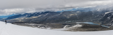View from the top of Mount Glitterthind to the Steinbuvatnet Lake, Jotunheimen National Park, Norway Stock Photo