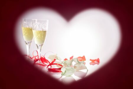 Valentines Day. Picture in the form of heart. Two glasses with white wine