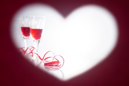 Valentines Day. Picture in the form of heart. Two glasses with red wine Stock Photo