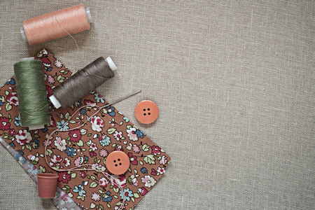 Accessories for sewing in natural pastel colors on the canvas