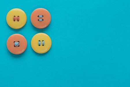 Pastel colors. Yellow and orange buttons on a blue background