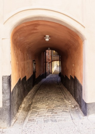 Narrow street in Old Town in Stockholm, Sweden Stock Photo