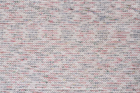 Textile background with coarse weave of white, pink and gray threads