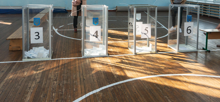 Transparent ballot boxes for ballots at the polling station. Elections in Ukraine