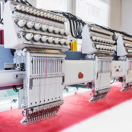 Industrial embroidery machine in textile production workshop