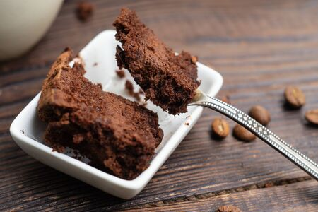 Chocolate truffle cake in a plate and on a fork. Close-up Stock Photo