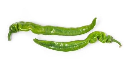 Two pods of green hot peppers on a white background Stock Photo
