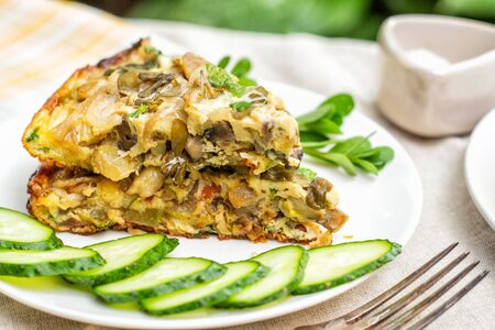 Frittata, an Italian dish made of whipped eggs, cheese and vegetables, cucumbers and purslane