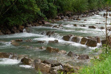 Mountain river Fuscher Ache with stepped riffles, Austria