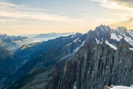 Rocky mountain cliffs in Mont Blanc massif at dawn. It is highest mountain range of western Europe