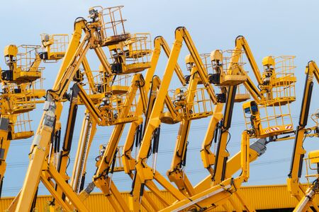 Lot of articulating boom lifts. Construction equipment manufacturing