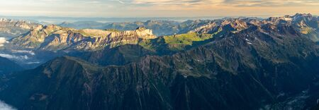 Panorama of mountain range at sunrise. French Alps. View from Aiguille du Midi Stok Fotoğraf