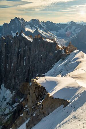 Rocky mountain cliffs and snow of Mont Blanc massif. View from Aiguille du Midi. Travel destination