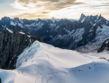 View from Aiguille du Midi, a mountain in the Mont Blanc massif within the French Alps. Climbing and tourist destination