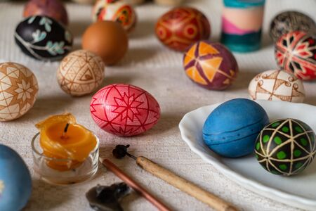 Multicolored traditional Ukrainian Easter eggs with a traditional geometric pattern, hot wax painted