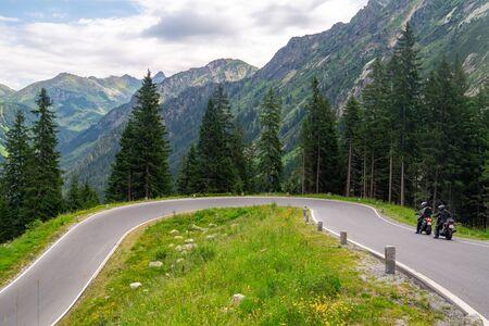 Silvretta High Alpine Road. Bikers on a serpentine of mountain tourist pass, Austria Standard-Bild - 140373326