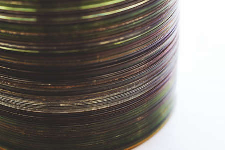 Lot of old compact discs stacked on a windowsill Archivio Fotografico