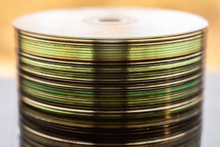 Lot of old compact discs stacked on a windowsill Фото со стока