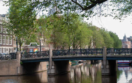 Bridge over a city channel at in Amsterdam, Netherlands