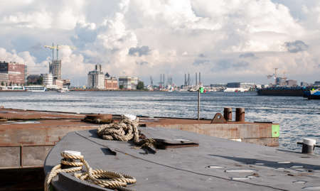 City panorama and mooring ropes at the port in Amsterdam, Netherlands