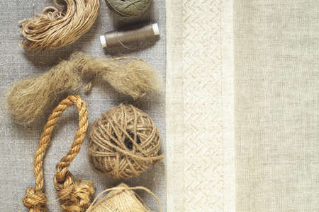 Linen textile products, fabric, threads, yarn and rope. Top view Archivio Fotografico