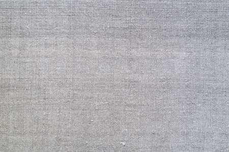 Texture of old homespun linen fabric. Rough textile. Background