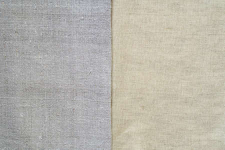 Texture of old and modern linen fabric. Homespun and factory textiles. Background