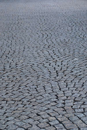 Backgsound of square paving stones on a city street