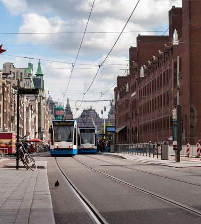 Tram on the street of the old city in Amsterdam, Netherlands Archivio Fotografico