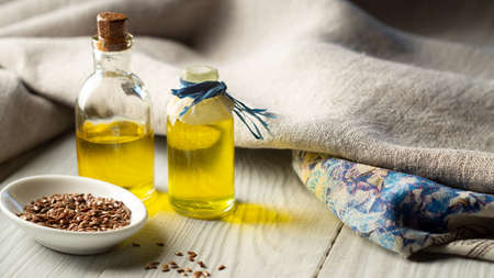 Flax products, linen textiles, flaxseed oil in bottles and flax seed Archivio Fotografico
