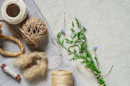 Linen textile products, fabric, threads, yarn, rope and blooming flax Archivio Fotografico