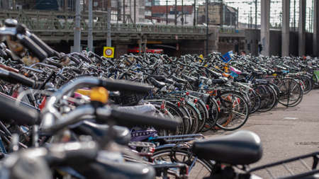 Lots of bikes in a parking lot in Amsterdam, Netherlands